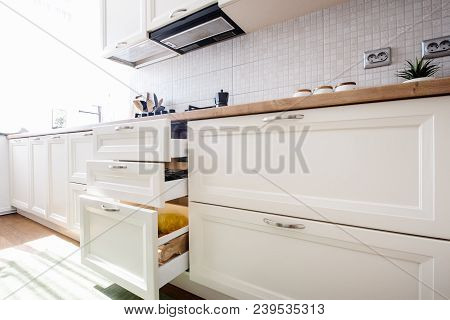 Modern Kitchen Furnishings And Cabinets With New Appliances