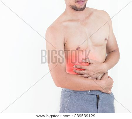 Young Man Feeling Unwell With A Stomach Ache On White Background.