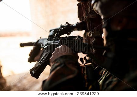 Soldier In War, With Weapons In His Hands, Aim At The Enemy