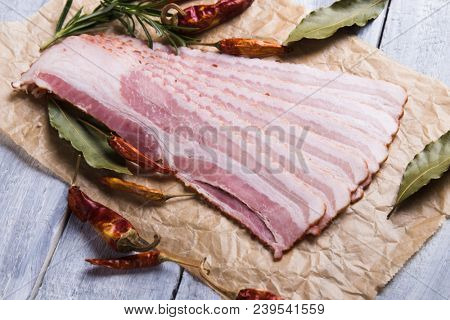 Slices of cured and smoked bacon ready for frying