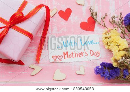 Happy Mother's Day Concept. Top View Of Gift Box With Flower, Wooden Red Heart And Tag With Love Mot