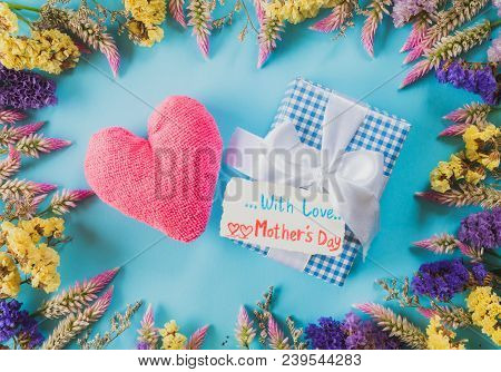 Happy Mother's Day Concept. Top View Of Gift Box With Flower, Paper Tag With Love Mother's Day Text