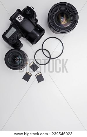 Dslr Camera, Lenses, Photo Equipment And Copy Space Over White Table Background