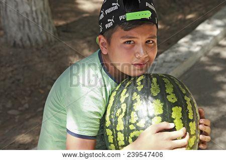 Ashgabat, Turkmenistan - August, 17 ,2017: Portrait Of  Unidentified  Asian Boy With A Large Waterme