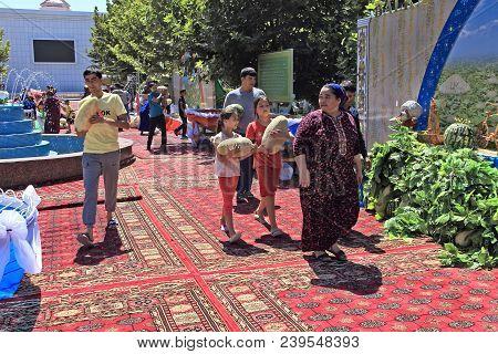 Ashgabat, Turkmenistan - August, 17 ,2017: Melon Festival In Turkmenistan. After The Festival, Peopl