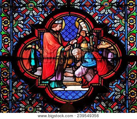 PARIS, FRANCE - JANUARY 05: Baptism of Clovis, first Christian King of France, stained glass window in the Basilica of Saint Clotilde in Paris, France on January 05, 2018.