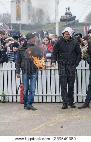 Tiraspol, Moldova - February 18, 2018: Men Are Preparing To Set Fire To The Stuffed Shrovetide. The