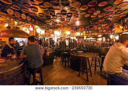 Brussels, Belgium - Apr 2: Many Drinking People Inside The Old Bar Delirium With Retro Furniture And