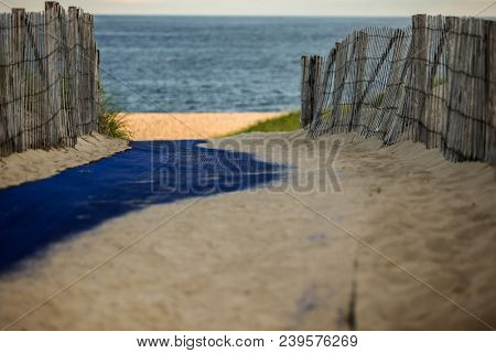 Beach scene with fence and selective focusing