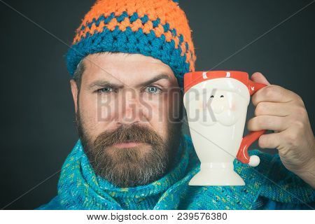Attractive Caucasian Man With Beard And Moustache In Hat And Scarf Enjoyed Drink. Handsome Bearded M