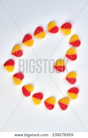Heart Made From Colorful Candies. Heart From Sugary Heart Shaped Candies On White Background With Co