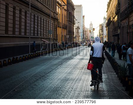 Mexico City, Mexico - January 14.2018: Man Riding A Bicycle On The Streets Of Mexico City At Golden