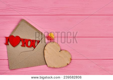 Valentines Day Pink Wooden Background. Envelope With Wooden Figure I Love You, Plywood Heart And Hea