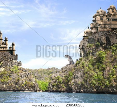 Beautiful fantasy landscape with the sea, high mountains, blue sky and old castles and giant stone statue of a lion