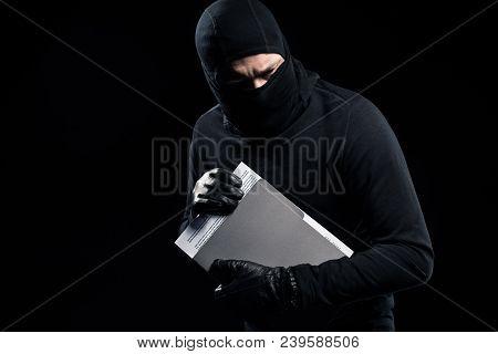 Burglar In Balaclava Holding Top Secret Documents