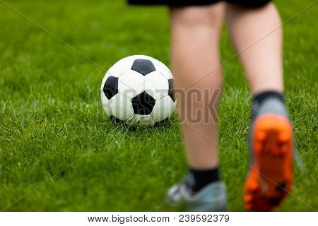 Football Or Soccer Ball At The Kickoff Of A Game. Soccer Free Kick At A Grass Pitch. Young Soccer Pl