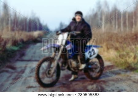 Blurred Motocross Racer  In Dirt Track On The Mountain Motocross Race In Dirt Track In Day Time. Blu