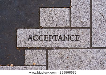 The Word Acceptance On A Motivational Brick Sidewalk Made Of Concrete And Mortar.