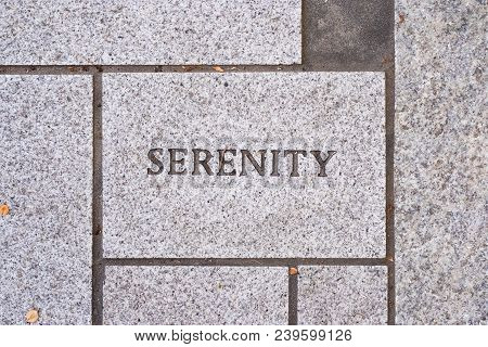 The Word Serenity On A Motivational Brick Sidewalk Made Of Concrete And Mortar.