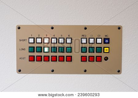 Retro Communications Intercom Device At A Nursing Care Facility Mounted To A White Wall With Buttons