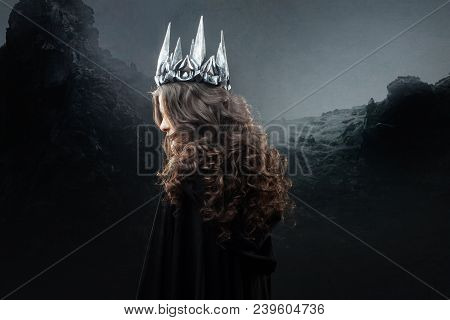Portrait Of A Gothic Princess. Beautiful Young Brunette Woman In Metal Crown And Black Cloak. Mystic