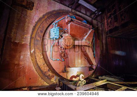 Large Hermetic Door Of Airlock Of Abandoned Bunker.