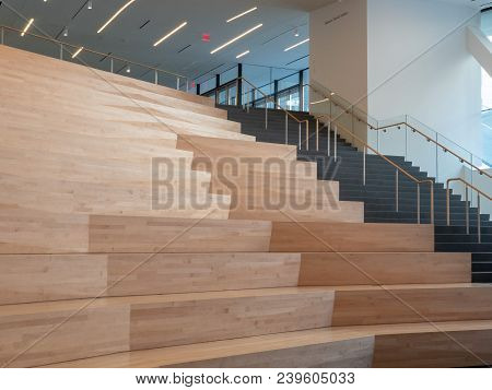 Wooden Auditorium Steps In A Modern Stage Area With Natural Light Filling The Area