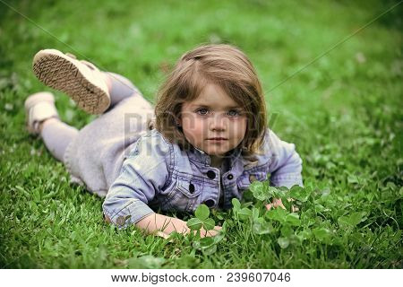 Little Girl Relax On Spring Or Summer Day Outdoor. Cute Child Lie On Green Grass Lawn. New Life, You