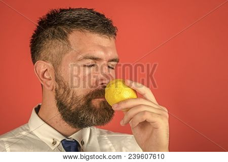 Vitamin Citrus At Hipster On Red Background. Vegetarian, Health And Wellbeing. Man With Long Beard S