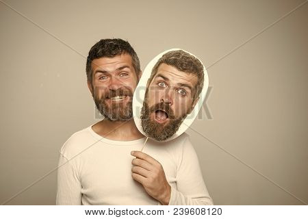 Hipster With Happy And Surprised Face Hold Portrait Nameplate. Man With Long Beard And Mustache. Fee