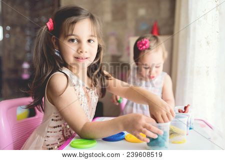 Little Girls Playing With Putty At Home