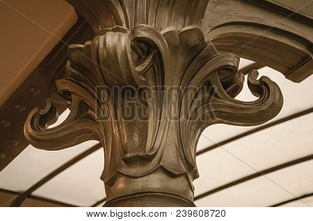 Detail Of Cast-iron Capital In Art Nouveau Style And Glass Ceiling In Brussels. Vibrant And Friendly