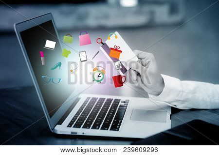 Beautiful Young Asian Woman Holding A Credit Card And Shopping Online With Using Laptop Computer At