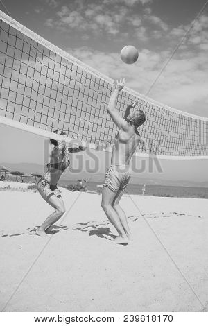 Beach Volleyball Concept. Couple Have Fun Playing Volleyball. Young Sporty Active Couple Beat Off Vo