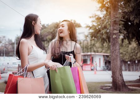 Funny Two Shopper Asian Woman Holding Paper Bag And Laugh Together.