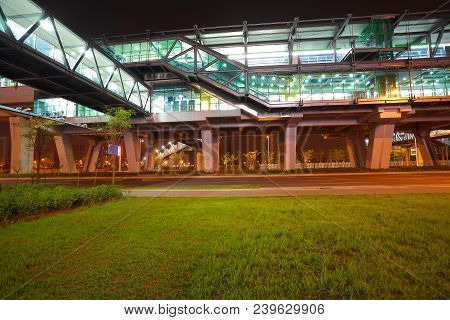 Empty Green Grass With Viaduct Bridge Of Night Scene