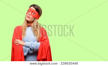 Young super woman with crossed arms confident and happy with a big natural smile laughing