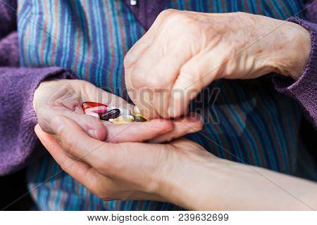 Elderly Woman Holding Medical Drugs