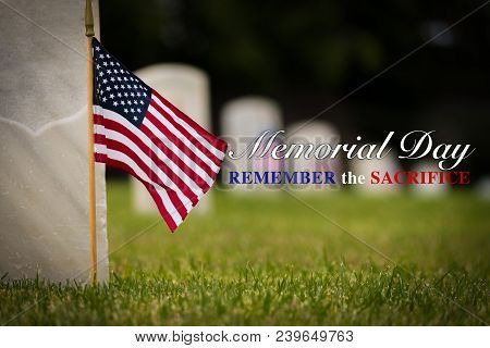 Small American flags and headstones at National cemetary- Memorial Day display - with copy poster