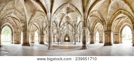 The historic Cloisters of Glasgow University. Panorama of the exterior walkway. Image taken from an outdoor public position.