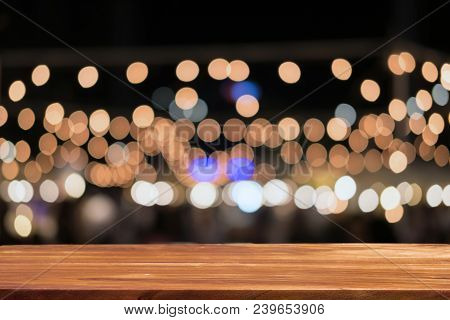 Empty Wooden Table In Front Of Abstract Blurred Background Of Bokeh . Can Be Used For Display Or Mon