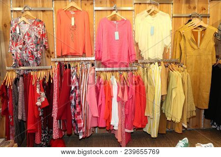 Clothes Hang On Clothes Rack In Clothing Classic Store Interior With Sweet Tone Red And Yellow