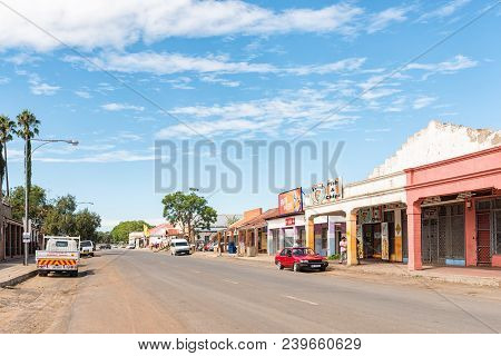 Colenso, South Africa - March 21, 2018: A Street Scene, With Businesses And Vehicles Visible, In Col