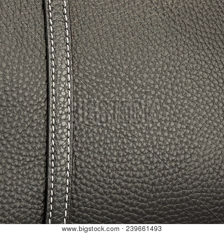 Texture Black Leather With One Neat Stitch Sewn With White Thread Closeup