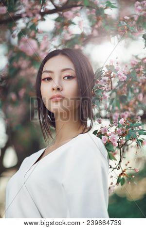 Gorgeous Asian Woman With Perfect Skin Creartive Art Make-up Wearing Trendy White Japanese Kimono St