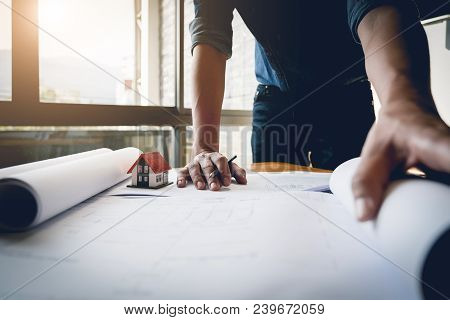 Close Up Hands Of Engineer Working On Blueprint Construction Concept. Engineering Tools. Vintage Ton