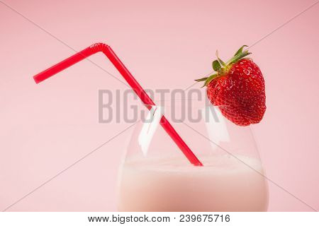 Pink Milkshake Drink From Strawberries In Drinking Glass With Strawberry Fruit And Red Drinking Stra