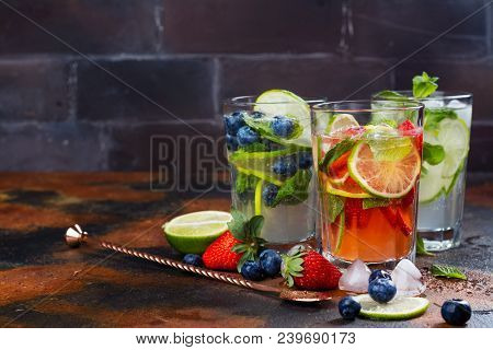 Summer Homemade Fruit And Berries Lemonade. Mojito, Lemonade And Sangria In Tall Glasses. Copy Space