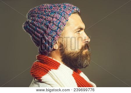 Side View Of Bearded Man In Scarf And Cap. Handsome Bearded Man. Serious Man With Beard Is Looking I