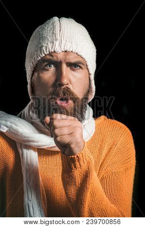 Patient With Cold Cough. Bearded Man Sick With Cold Coughs. Sick Man In Sweater, Hat And Scarf While